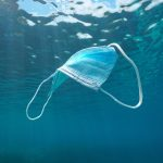 Surgical face mask underwater pollution in ocean