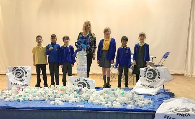 The Plastic Free Action Group with actual quantities of bottles used per week at the school in a radical assembly to announce their plastic free week.