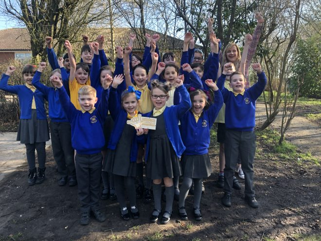 Canon Burrows celebrating with their Plastic Free School Plaque.