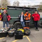 Volunteers with collected plastic in bins